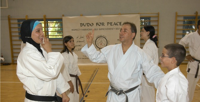 Danny Hakim with some of the members of Budo for Peace.