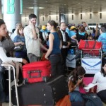Travelers stuck at Ben Gurion Airport during a strike. Photo by Roni Schutzer/Flash90