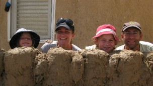 A family volunteering through Go-Eco.