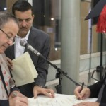 From left, Jordanian Red Crescent director Dr. Mohammed al-Hadid (with assistant Mohd Hadid), signing diplomas with BGU Rector Prof. Zvi Hacohen. Photo by Yoav Galai/BGU