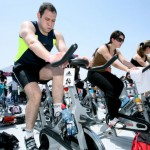 Four hours of physical activity like spinning a week will help employees avoid the effects of burnout and depression at work. Photo by Moshe Shai/Flash90.