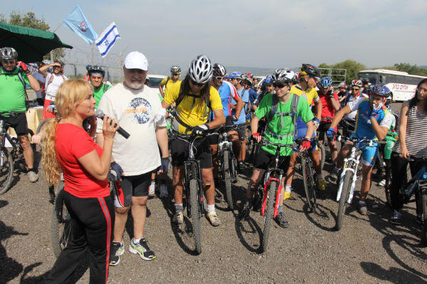 Gilad Shalit cycles with Arab and Jewish Israelis on the Cycling for Peace run.