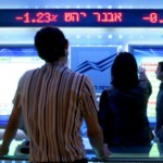 Traders anxiously follow stock fluctuations at the Tel Aviv Stock Exchange. Photo by Moshe Shai/Flash90.