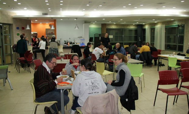One of the goals of Café Motek is to socially integrate people with and without psychiatric disabilities. Photo courtesy of Enosh