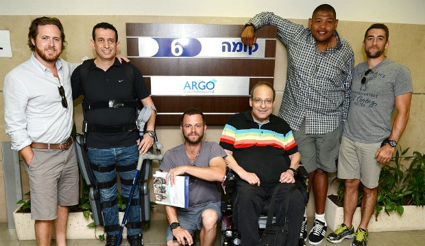 Buckley, Giovinazzo, Miller and Togo getting an up-close look at the ARGO ReWalk with test pilot Radi Kaiuf (wearing the exoskeleton) and founder Dr. Amit Goffer. Photo by Michael Kovac/WireImage