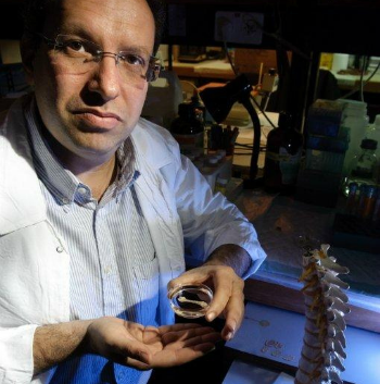 Dr. Shai Meretzki with the unique system for making new human bone.