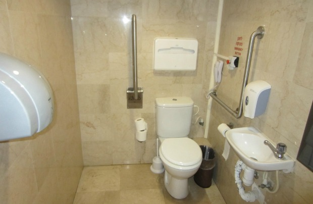 The bathroom in an accessible room at the Haifa Crowne Plaza has all the right requirements: plenty of space for a wheelchair, grab bars, panic button, phone, and a sink that the chair can roll right up to. There's also a roll-in shower.