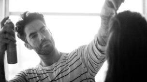 Antonio Corral Colero using Moroccanoil on a model's hair.