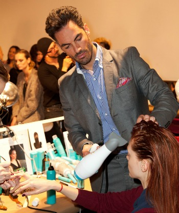 Corral Colero demonstrating Moroccanoil before a runway show.