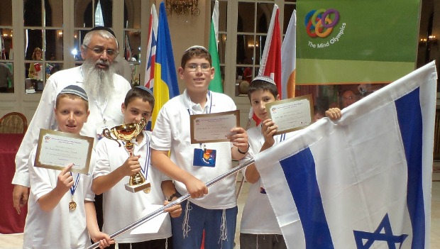 The winning Israeli team: From left, Ori Lifshitz, Aviad Loberbaum, Yehuda Klein and Avi Klein with coach Moshe Ben-Ami.