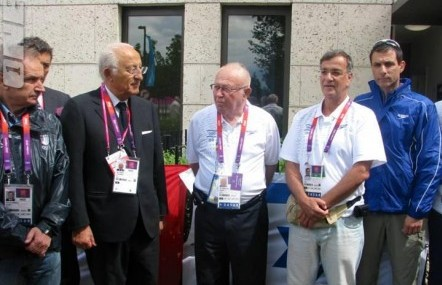 IOC secretary-general Efraim Zinger and Zvi Varshaviak, president of the IOC, with the Italians at the memorial ceremony. (IOC)
