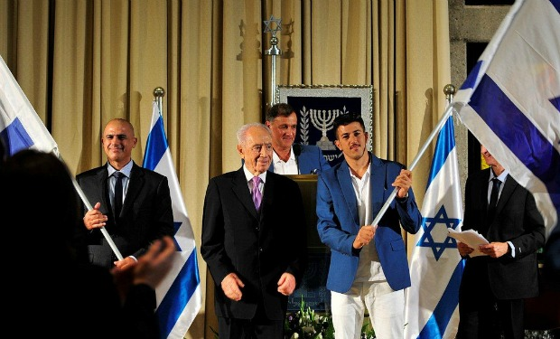 From left, Doron Shaziri, President Shimon Perez and Shahar Zubari at the Olympic and Paralympic sendoff at the President's Residence, with Israel Olympic Committee secretary-general Efraim Zinger in background. Photo by Razi Livnat