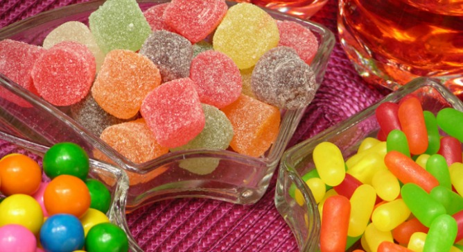 The reds and oranges in candies don't have to be from synthetic dyes.