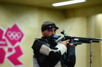 Sergey Richter competes in the men's 10m Air Rifle qualification at The Royal Artillery Barracks in London.