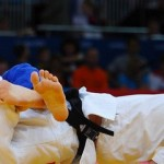 Germany's Dimitri Peters (blue) puts Israeli judoka Arik Zeevi in a headlock. (Olympics London 2012)
