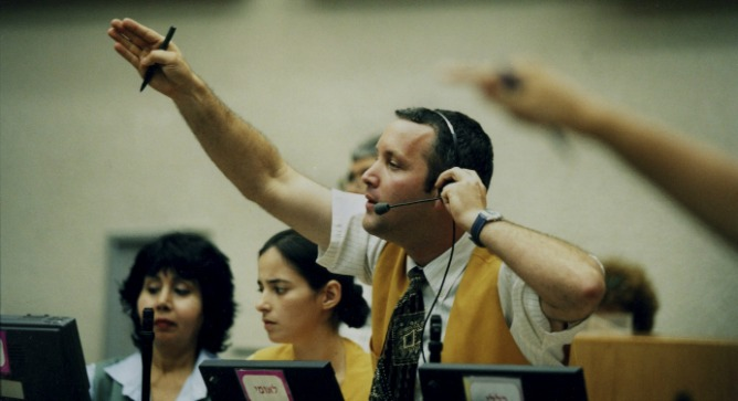 A broker at the Tel Aviv Stock Exchange. Photo by Flash90.