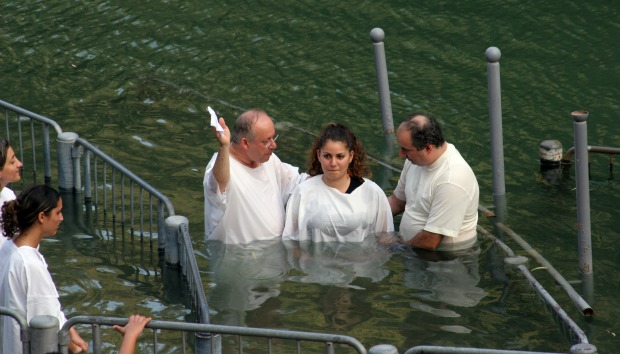 Baptism at the River Jordan. Photo by www.shutterstock.com