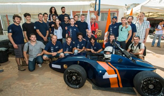 Proud teammates with their Formula racer. Photo by Dani Machlis