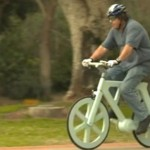Izhar Gafni goes for a spin on his cardboard bike.