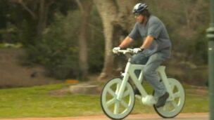 Izhar Gafni goes for a spin on his cardboard bike.
