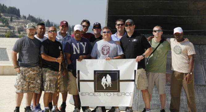 The 10 team members and two coaches of Heroes to Heroes 2012 visiting the 9/11 memorial in Jerusalem. Photo by Eilon Levy.