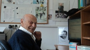 Citri at his university office, surrounded by photos of his late wife and son, along with other diagnostic kits he's invented. Photo by Lorena Sabater