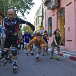 Rollerbladers ride through the streets of Tel Aviv on one of their weekly jaunts. Photo by Flash90.