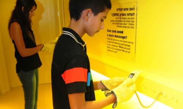 Trying to send text messages while wearing gloves simulates difficulties older people may experience.