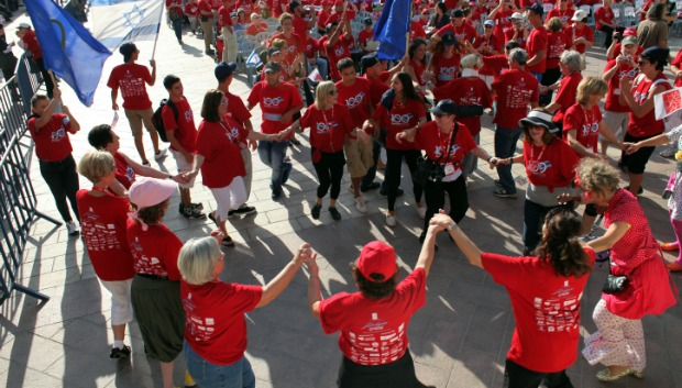 Hadassah members celebrating the organization's centennial with a parade in downtown Jerusalem. Photo by Yoav Ari Dudkevitch/FLASH90