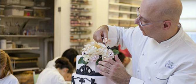 Ron Ben-Israel putting the finishing touches on one of his wedding cakes.