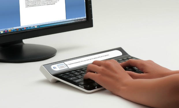 An embedded screen lets Smartype users see what they're typing without looking up at the screen. Photo by Amos Bar-Ze'ev