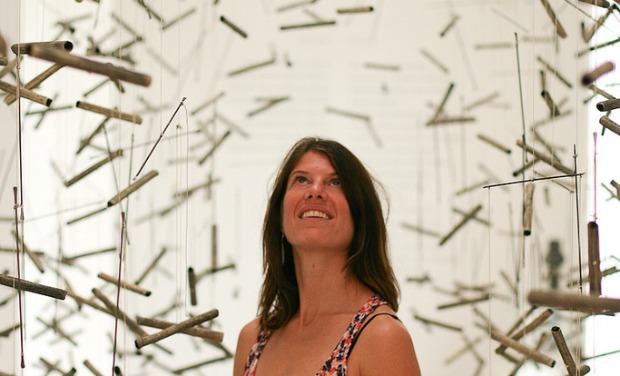 "Mizel Museum Curator Georgina Kolber in Andi Arnovitz's ""A Delicate Balance"" in the Ein Harod Museum of Art. Photo by Alyssa Kapnik"