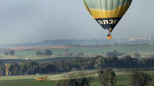 A hot air balloon flies over the Israeli countryside. Photo by Moshe Shai/Flash90.