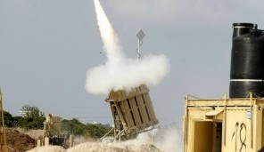 Israeli soldiers take cover as an Iron Dome battery intercepts a rocket fired from Gaza, November 19, 2012. Photo by Edi Israel/Flash90
