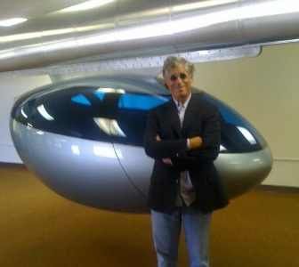 CEO Jerry Sanders with a skyTran module.