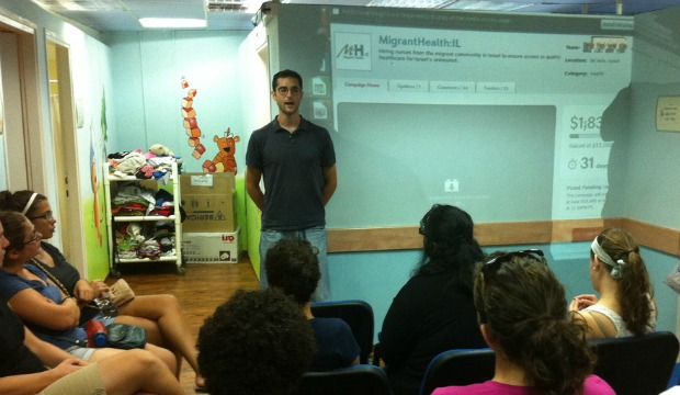Dr. Jonah Mink explaining MigrantHealth:IL to 100 medical students from Tel Aviv and Ben-Gurion universities.
