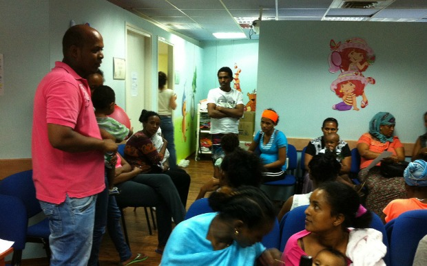 An Eritrean nurse educating Tel Aviv migrant mothers about vitamin D.