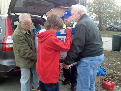 Roger Parrott, Jacob Parrott and Joel Leyden (in blue hat) delivering a generator and gas to a Hurricane Sandy victim. Photo courtesy of Israel News Agency