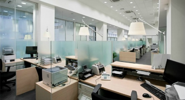 Lights on in empty offices are a big money waster. Image via Shutterstock.