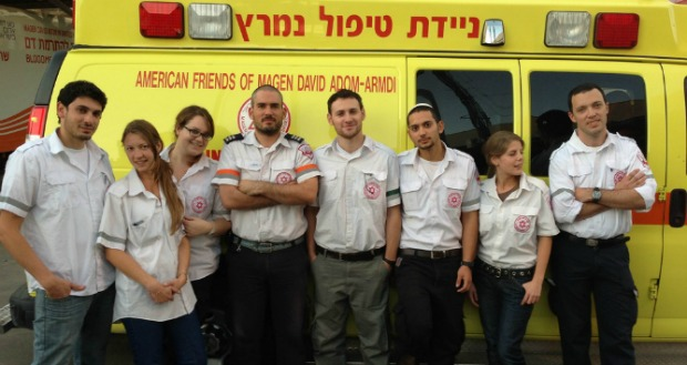 Paramedics-in-training from Ben-Gurion University of the Negev aren't in class during the conflict, so they are volunteering with the local ambulance squad. Coordinator Oren Wacht is in the middle. Photo courtesy of Ben-Gurion University