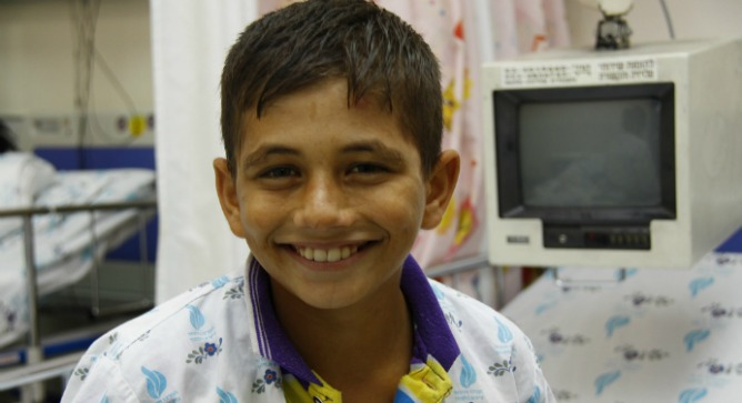 Mohamed Ashgar from Gaza waiting for his heart sugery. Photo by Sheila Shalhevet.