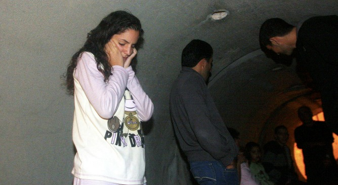 sraeli residents take shelter against incoming rockets after a warning siren in Nitzan. Photo by Flash90.