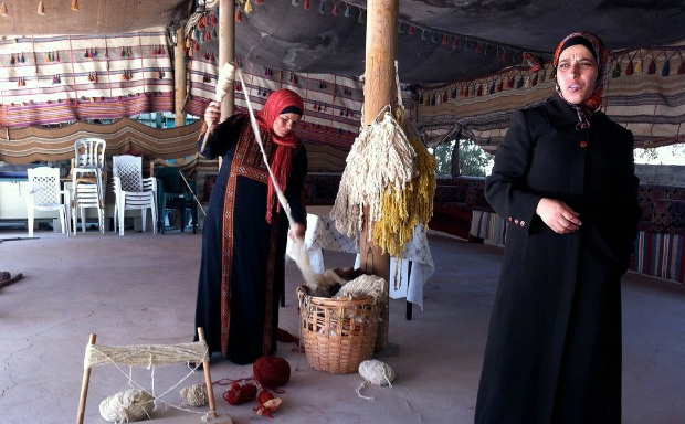 Fatima Abu Ghanim, right, leading a weaving workshop.