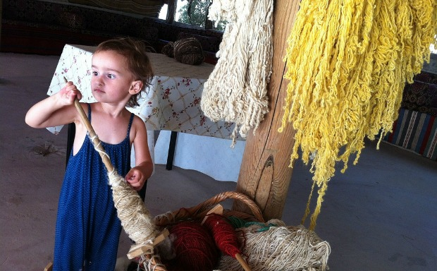 The author's daughter exploring hand-dyed spools at Sidreh.