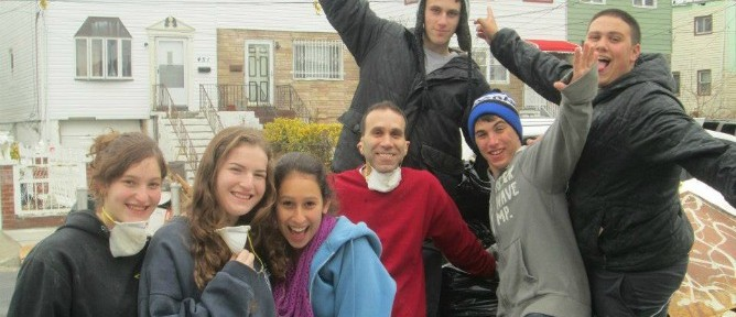 Ayelet Koplon, Lipaz Hirsch, Dafna Katz, Stuart Katz (in red sweatshirt), Brad Eckman, Yoni Wolf and Rami Lesnick participating in a cleanup at Arverne, a neighborhood on the hard-hit Rockaway Peninsula in New York.