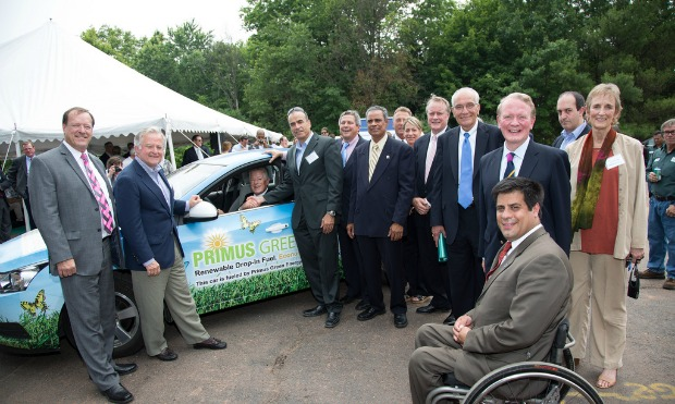 Primus Green Energy executives and guests checking out the demo vehicle fueled by Primus biofuel.