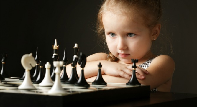 Previous research suggests that playing chess will improve reading performance and school grades in children. Photo via www.Shutterstock.com