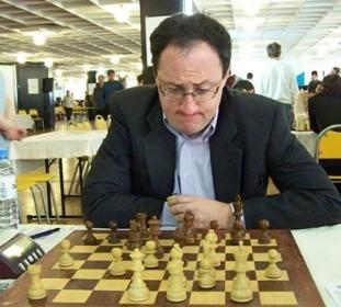 Grandmaster Gelfand pondering a move.