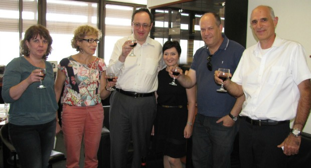 Making a toast to the new scientific chess study at the University of Haifa are, from left, Rosa Leikin, head of the Interdisciplinary Center for Research and Advancement of Excellence and Giftedness; VP and Dean of Research Prof. Michal Yerushalmy; Grandmaster Boris Gelfand; Maya Gelfand; researcher Shay Bushinsky; and legal adviser Doron Schweppe. Photo courtesy of University of Haifa.