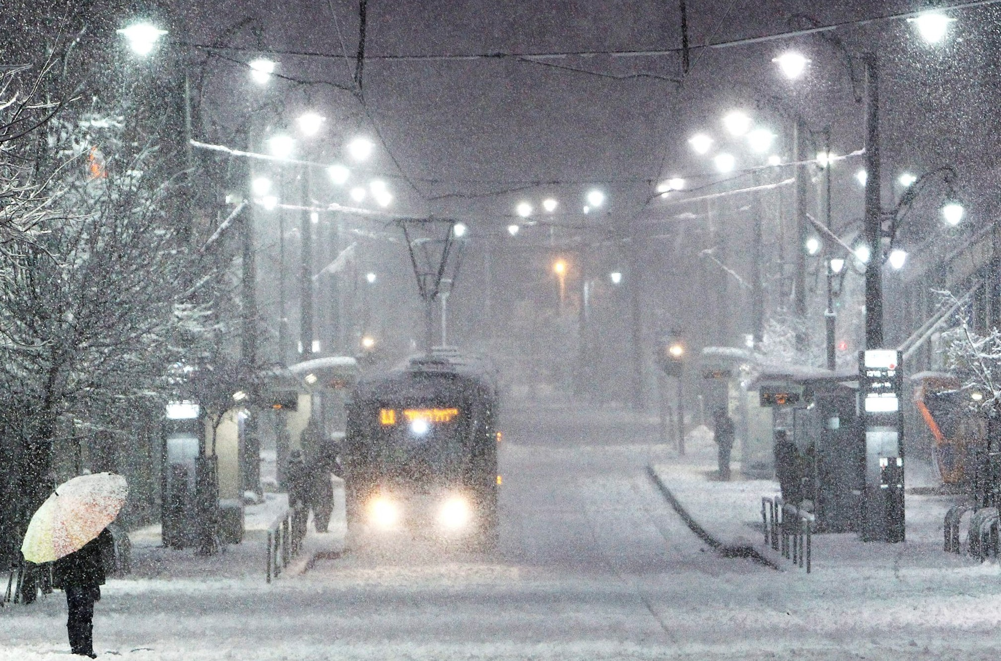 Jerusalem's light rail makes its way through the holy city covered in snow. (Flash90)